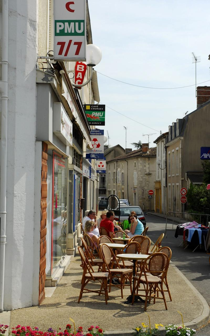 Street cafe scene in Civray, France - Credit: Brough Tomlinson/Alamy
