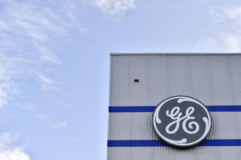 Troubled US industrial giant GE reports a $22.8 billion third quarter loss as it writes down assets as part of a turn-around bid (AFP Photo/LOIC VENANCE)