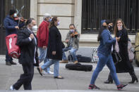 Street musicians play for passers-by in Madrid, Spain, Sunday, Nov. 15, 2020. Spain continues with new measures against the COVID-19 while suffering a second strong pandemic crisis by Coronavirus. (AP Photo/Paul White)
