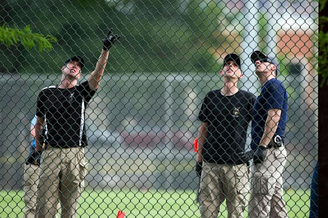 <p>A FBI Evidence Response Team looks for evidence on the baseball field in Alexandria, Va., Wednesday, June 14, 2017, after a rifle-wielding attacker opened fire on Republican lawmakers at a congressional baseball practice, wounding House GOP Whip Steve Scalise of Louisiana and several others as congressmen and aides dove for cover. (Photo: Cliff Owen/AP) </p>
