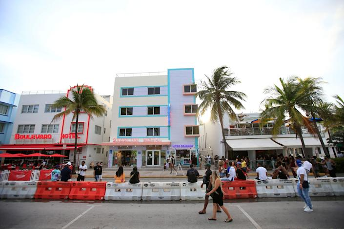 People gather on Ocean Drive on 3 July in the South Beach neighborhood of Miami Beach, Florida: Cliff Hawkins/Getty Images