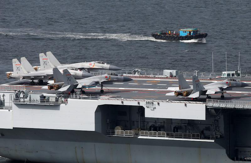 Fighter jets and helicopters are seen on board China's aircraft carrier Liaoning