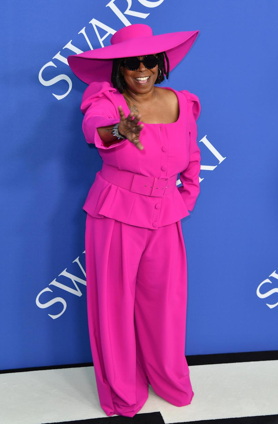 <p>All hail the Queen. Whoopi Goldberg stole the show at the CFDA Awards in a hot pink co-ord with, wait for it, a co-ordinating hat. <em>[Photo: Getty]</em> </p>