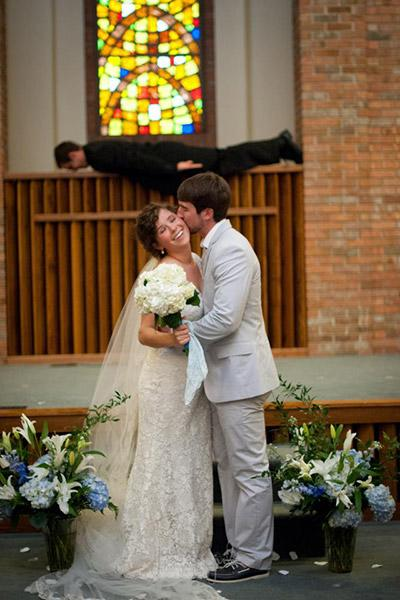 """<div class=""""caption-credit"""">Photo by: awhiteghost on Imgur</div><div class=""""caption-title"""">You May Kiss The Bride</div><p>  It's safe to assume that this planking pastor is on board with the wedding. </p> <p>  <i>Have a photobomb of your own that you'd like to share? Upload your pic to</i> <i><a>BG's Facebook page</a> or</i><i><a>submit it to us via Instagram</a> (be sure to include the hashtag #bgphotobombs) and we may add it to our list!</i> </p>"""