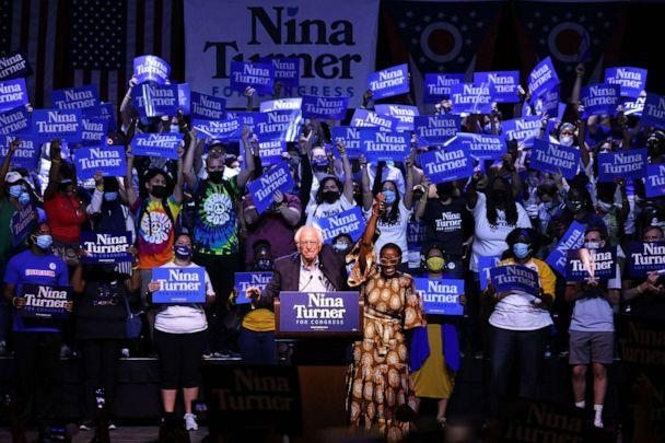 PHOTO: Sen. Bernie Sanders raises the hand of Congressional Candidate Nina Turner during a Get Out the Vote rally, July 31, 2021, in Cleveland. (Michael M. Santiago/Getty Images)