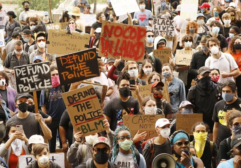 """Students and community members marched June 16 from the Miguel Contreras Learning Complex to L.A. Unified headquarters, where they urged the district to defund school police. <span class=""""copyright"""">(Al Seib / Los Angeles Times)</span>"""