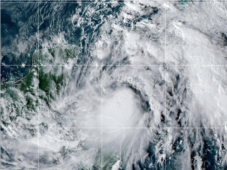This satellite image provided by the National Oceanic and Atmospheric Administration shows Tropical Storm Zeta,, on Sunday 25 October at 2110 GMT (5:10 p.m. ET) ((Associated Press))