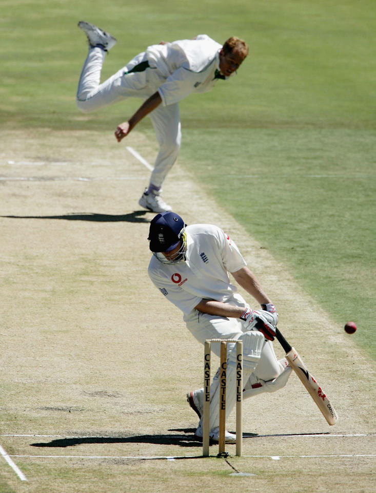 PRETORIA, SOUTH AFRICA - JANUARY 24:  Andrew Flintoff of England avoids a bouncer from Shaun Pollock of South Africa during day 4 of the 5th Test between South Africa and England on January 24 2005 at Centurion Cricket Ground,  Pretoria, South Africa  (Photo by Tom Shaw/Getty Images)