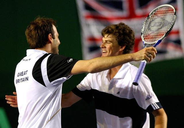 Rusedski, left, and Jamie Murray celebrate after beating Holland's Robin Haase and Rogier Wassen at Birmingham's NEC Arena