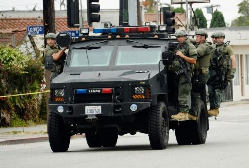 Army or police? Los Angeles police aboard an armored car in 2019