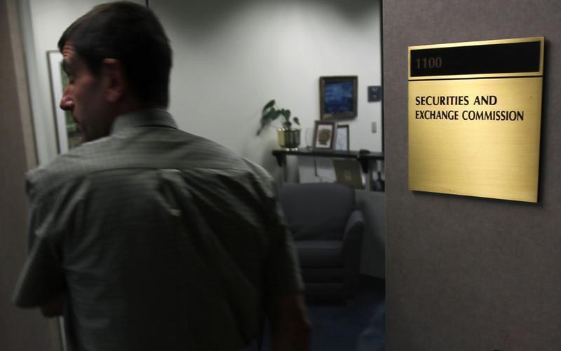 A man walks past a doorway at the Fort Worth Regional Office of the SEC in Fort Worth