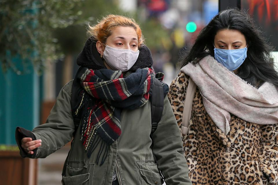 Women wearing masks as a preventive measure against the spread of covid-19 walk along the Street in London. Over 83,200 people have died from Covid-19 in the UK. The government is likely to enforce people must wear a face covering whilst outside, unless they are medically exempt. (Photo by Dinendra Haria / SOPA Images/Sipa USA)