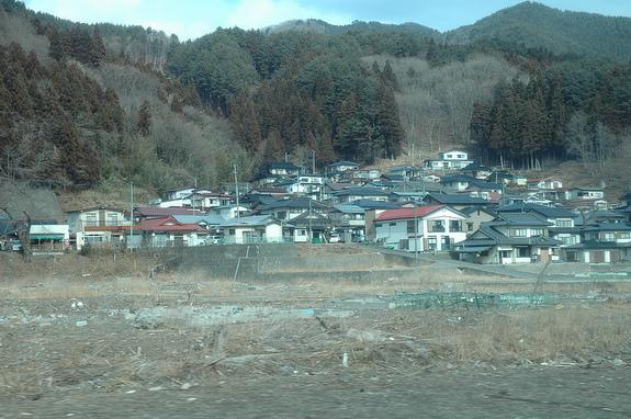 Houses above the inundation zone in this Japanese village survived intact, while everything below was destroyed by the 2011 tsunami.