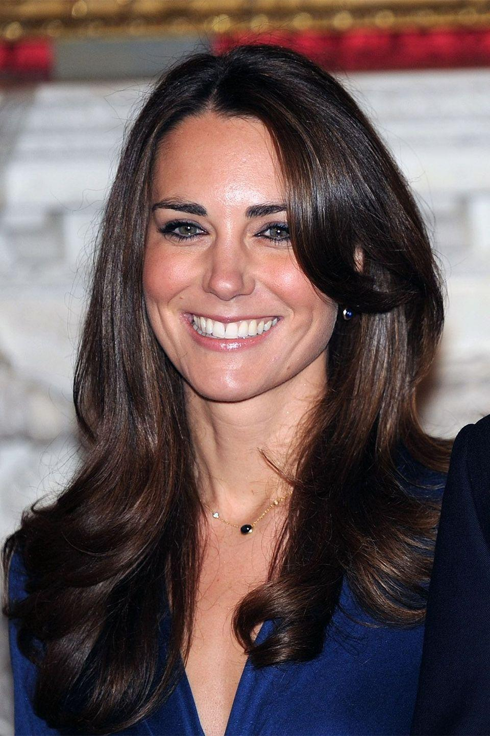 <p>The birth of the Duchess of Cambridge's iconic bouncy blow-dry in her engagement photo</p>