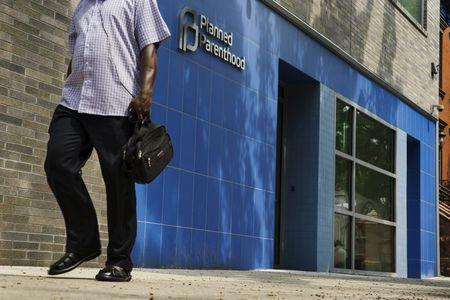 A man walks past the entrance to a Planned Parenthood building in New York August 31, 2015. REUTERS/Lucas Jackson