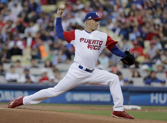 <p>Puerto Rico pitcher Seth Lugo throws against the United States during the first inning of the final in the World Baseball Classic in Los Angeles, Wednesday, March 22, 2017. (AP Photo/Jae C. Hong) </p>