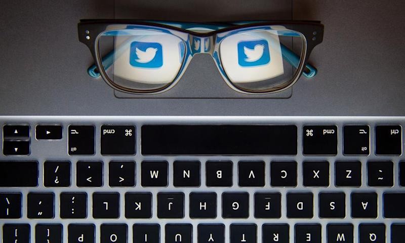 The Twitter bird logo reflected in a pair of glasses