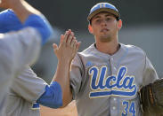 UCLA pitcher Cody Poteet (34) is greeted as he comes off the field after the sixth inning against Cal State Bakersfield during an NCAA college baseball tournament regional game in Los Angeles on Sunday, May 31, 2015. (AP Photo/Jayne Kamin-Oncea)