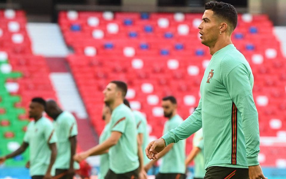 Cristiano Ronaldo leads his Portugal teammates out to inspect the pitch at the Allianz Arena - AFP