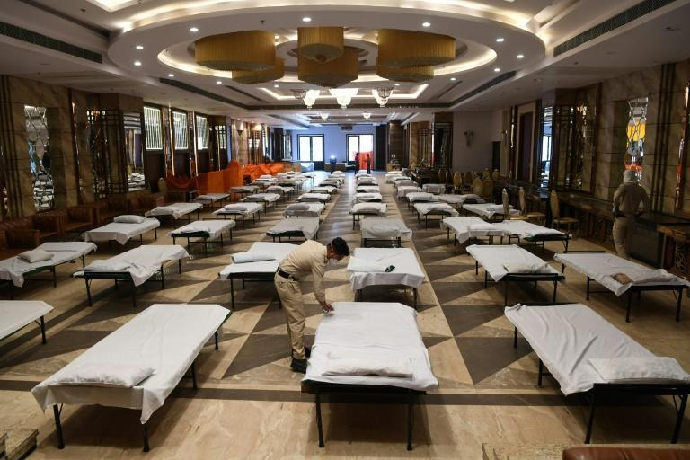 Indian authorities have taken over hotels and banquet halls to accommodate coronavirus patients (AFP Photo/Prakash SINGH)