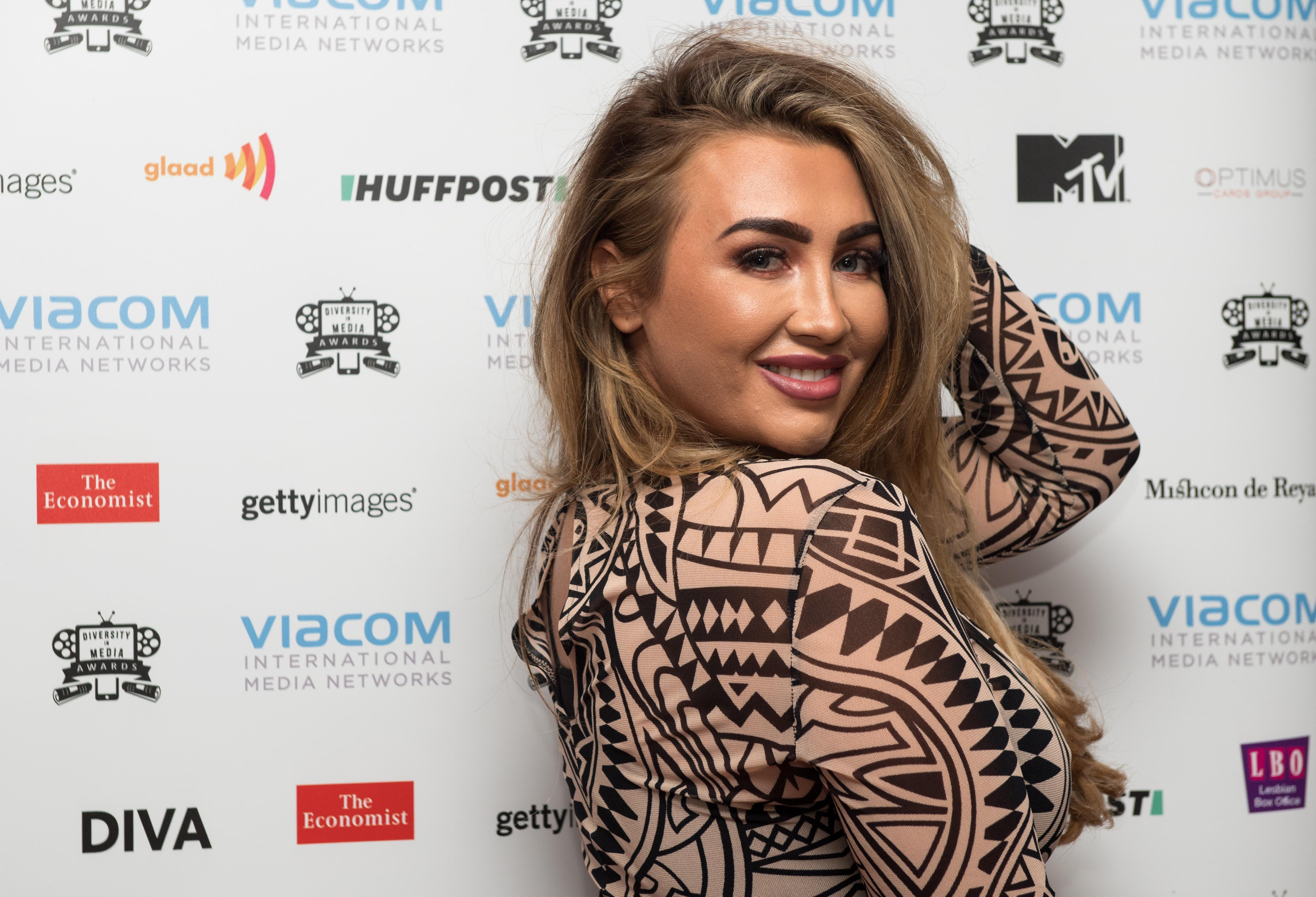 LONDON, ENGLAND - SEPTEMBER 15: Lauren Goodger poses for photographs at the Diversity in Media Awards on September 15, 2017 in London, England. (Photo by Chris J Ratcliffe/Getty Images)