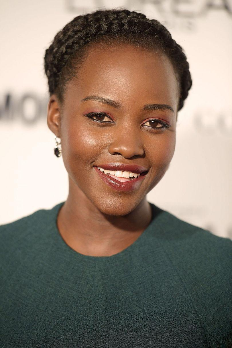 <p>Keeping it classic with a double halo braid is hair chameleon Lupita Nyong'o.</p>