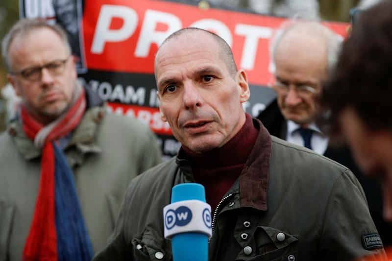 Former Greek Finance Minister Yanis Varoufakis talks to the media as he leaves Belmarsh Prison after visiting Julian Assange (REUTERS)