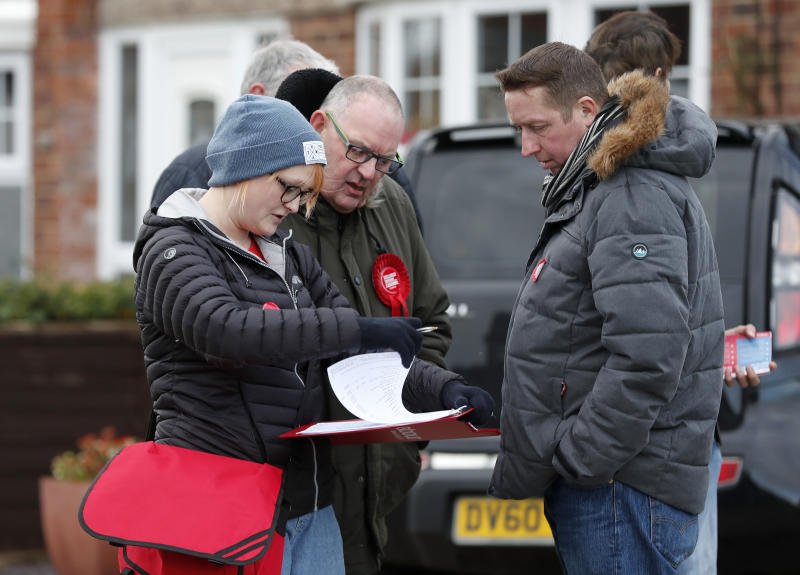 The Labour campaign team plan their tour in Hartlepool, England, Monday, Nov. 11, 2019. Hartlepool has elected lawmakers from the left-of-center Labour Party for more than half a century. But in 2016, almost 70% of voters here backed leaving the European Union. (AP Photo/Frank Augstein)