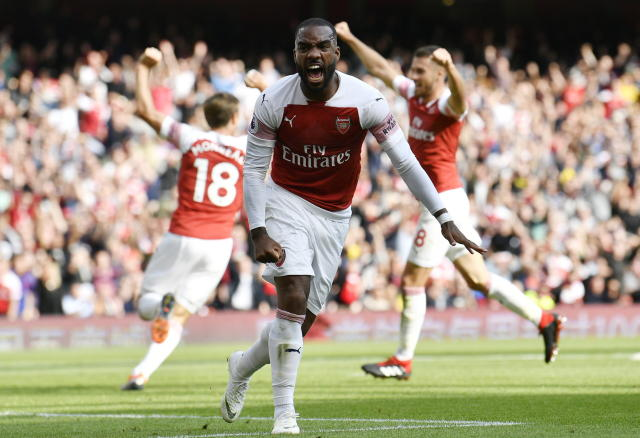 Arsenal's Alexandre Lacazette reacts after West Ham's Issa Diop scores an own goal