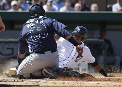 Detroit Tigers' Argenis Diaz is tagged out at home by Tampa Bay Rays catcher Jose Molina during the fifth inning of a spring training baseball game, Friday, March 29, 2013 in Lakeland, Fla. Diaz was trying to score from second on a single to left field by teammate Omar Infante. (AP Photo/Carlos Osorio)