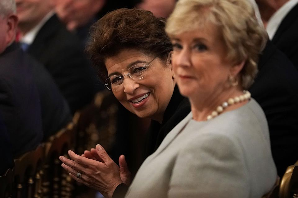 """WASHINGTON, DC - JUNE 29:  Treasurer of the United States Jovita Carranza (L), and Administrator of Small Business Administration Linda McMahon (R),  attend an event at the East Room of the White House June 29, 2018 in Washington, DC. Trump held the event for """"celebrating the six month anniversary of the Tax Cuts and Jobs Act.""""  (Photo by Alex Wong/Getty Images)"""