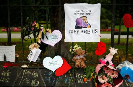 Flowers and signs are seen at a memorial site for victims of the mosque shootings, at the Botanic Gardens in Christchurch