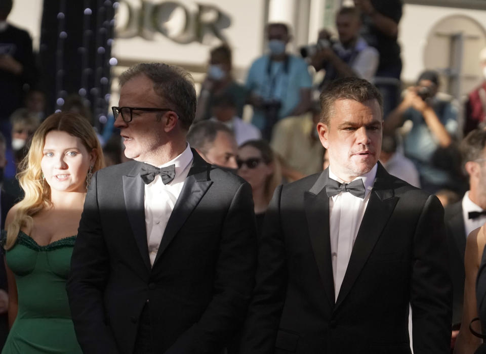 Abigail Breslin, from left, director Tom McCarthy, and Matt Damon pose for photographers upon arrival at the premiere of the film 'Stillwater' at the 74th international film festival, Cannes, southern France, Thursday, July 8, 2021. (AP Photo/Brynn Anderson)