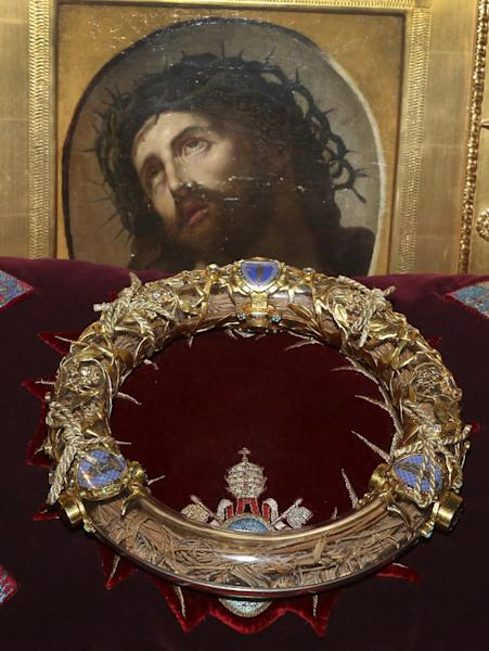 A crown of thorns which was believed to have been worn by Jesus Christ and which was bought by King Louis IX in 1239 is presented at Notre Dame Cathedral in Paris, Friday March 21, 2014. To mark the 800th anniversary of Louis IX's christening, the crown of thorns will be displayed outside Notre Dame, at the Collegiate Church of Poissy, where King Louis IX was christened. (AP Photo/Remy de la Mauviniere)