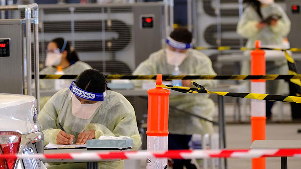 Victorian health care workers wearing PPE at a Covid-19 testing centre.