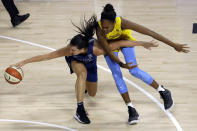 Minnesota Lynx forward Bridget Carleton (6) loses control of the ball as she runs into Chicago Sky forward Azura Stevens (30) during the second half of a WNBA basketball game Thursday, July 30, 2020, in Bradenton, Fla. (AP Photo/Chris O'Meara)