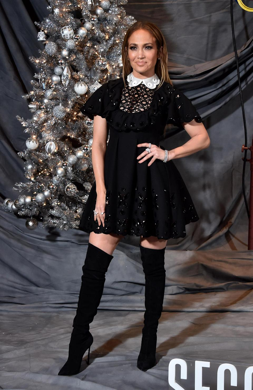 <p>The singer opted for a Valentino mini dress paired with knee-high boots. <em>[Photo: Getty]</em> </p>