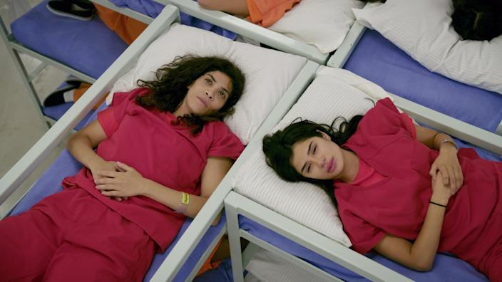 """Blanca Flores (Laura Gomez, left) and Maritza Ramos (Diane Guerrero) at an ICE detention center on """"Orange Is the New Black."""""""