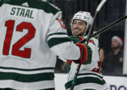 Minnesota Wild right wing Mats Zuccarello (36) celebrates after scoring against the Vegas Golden Knights during the first period of an NHL hockey game Tuesday, Dec. 17, 2019, in Las Vegas. (AP Photo/John Locher)