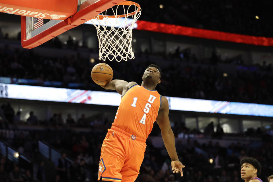 Team USA forward Zion Williamson, of the New Orleans Pelicans, goes up for a dunk against Team World during the second half of the NBA Rising Stars basketball game in Chicago, Friday, Feb. 14, 2020. (AP Photo/Nam Y. Huh)