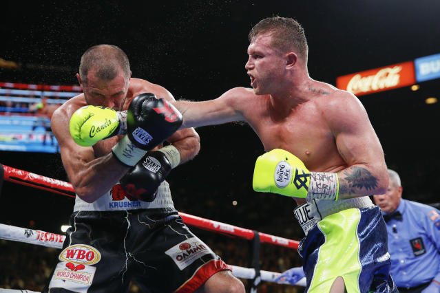 Canelo Alvarez, right, lands a punch against Sergey Kovalev during a light heavyweight WBO title bout, Saturday, Nov. 2, 2019, in Las Vegas (AP Photo/John Locher)
