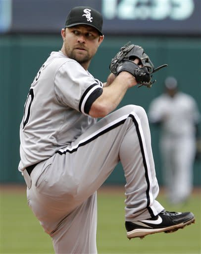 Chicago White Sox starting pitcher John Danks pitches against the Cleveland Indians in the first inning of a baseball game in Cleveland on Wednesday, April 11, 2012. (AP Photo/Amy Sancetta)