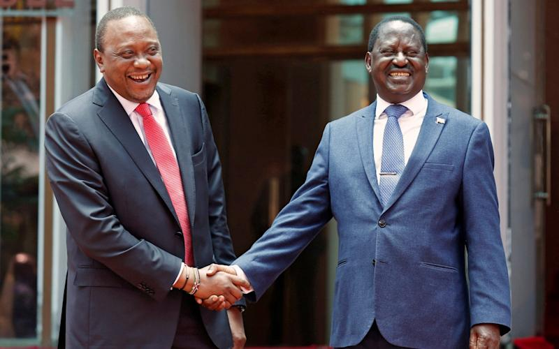 Kenya's President Uhuru Kenyatta (L) greets opposition leader Raila Odinga of the National Super Alliance (NASA) coalition after addressing a news conference at the Harambee house office in Nairobi, Kenya March 9 - REUTERS