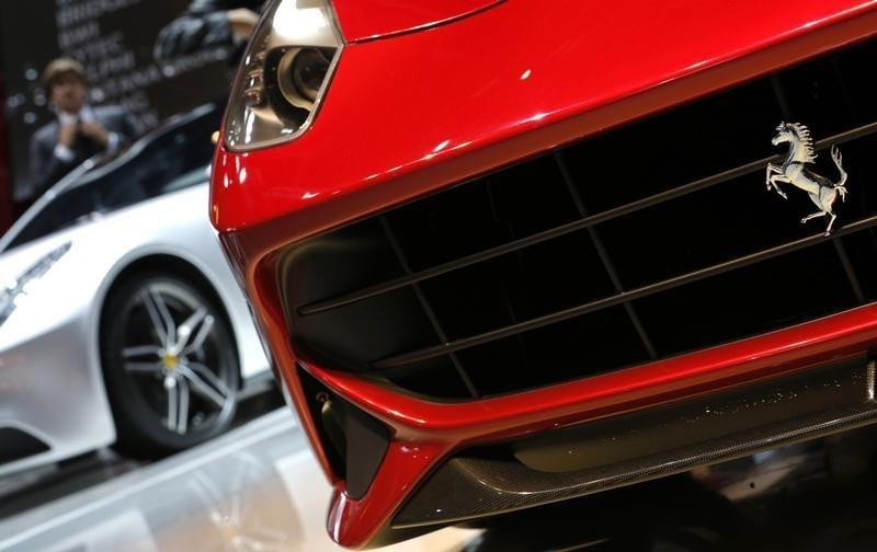A logo is seen on a new Ferrari Berlinette car displayed on media day at the Paris Mondial de l'Automobile