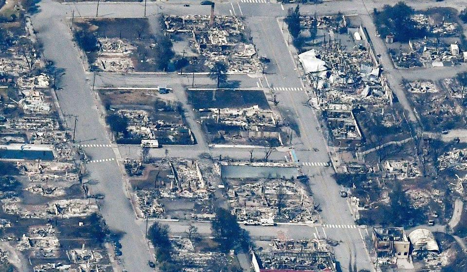 The charred remnants of homes and buildings, destroyed by a wildfire on June 30, are seen in this aerial photo of Lytton, British Columbia, on Tuesday. Photo: Reuters