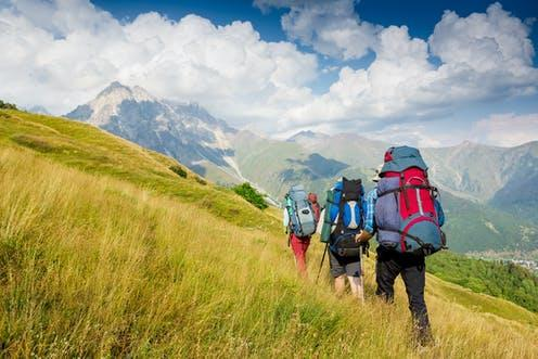 """<span class=""""caption"""">Hiking uses more energy than a regular walk in the park does.</span> <span class=""""attribution""""><a class=""""link rapid-noclick-resp"""" href=""""https://www.shutterstock.com/image-photo/hiking-team-travel-sport-lifestyle-concept-217133026"""" rel=""""nofollow noopener"""" target=""""_blank"""" data-ylk=""""slk:Olga Danylenko/ Shutterstock"""">Olga Danylenko/ Shutterstock</a></span>"""