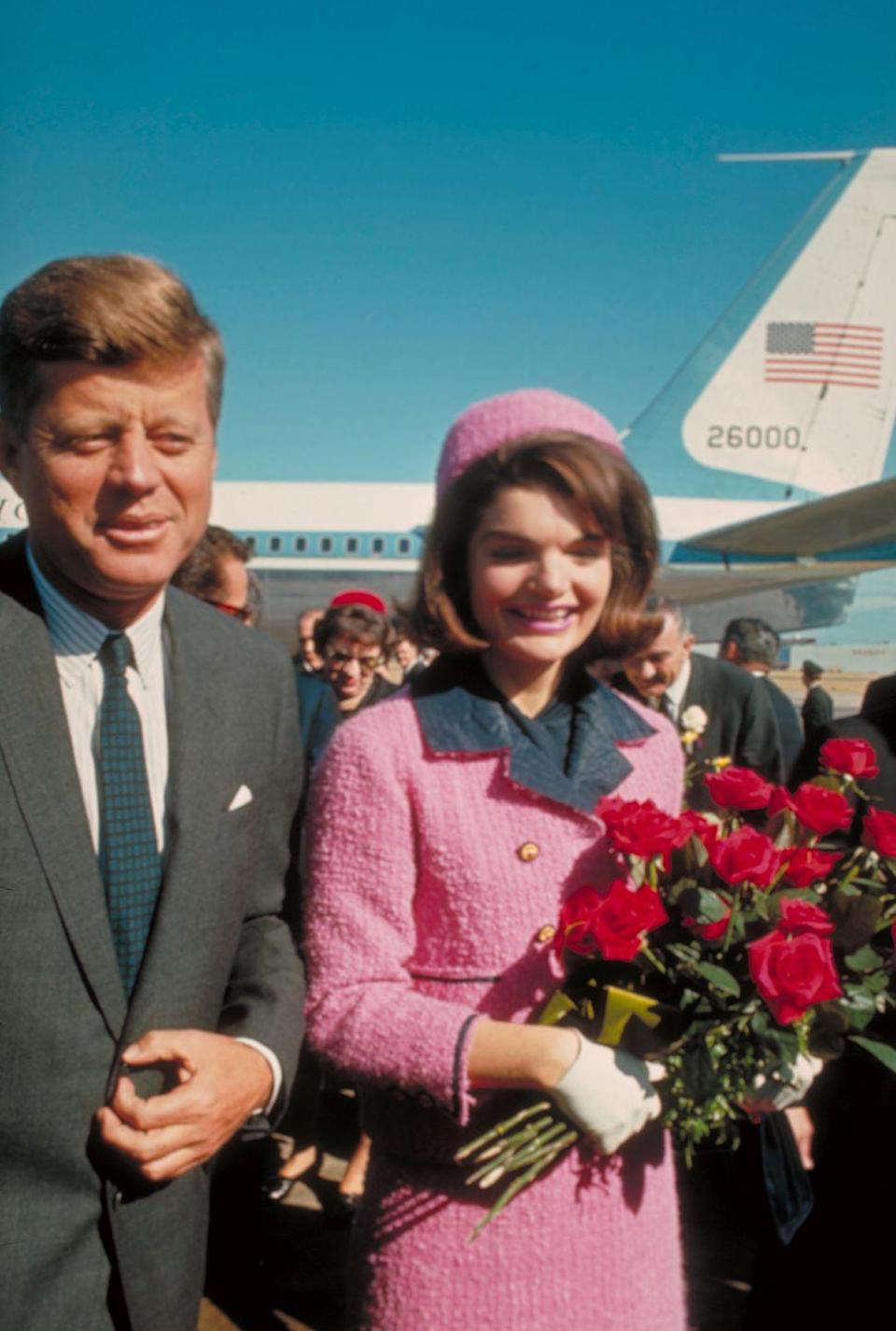 """<p>Jackie was sitting next to JFK wearing her iconic pink <a href=""""http://www.history.com/news/10-things-you-may-not-know-about-jacqueline-kennedy-onassis"""" rel=""""nofollow noopener"""" target=""""_blank"""" data-ylk=""""slk:suit"""" class=""""link rapid-noclick-resp"""">suit</a> when he was assassinated in 1963. She refused to change out of the suit even when Johnson was sworn in as president. Lady Bird Johnson asked if she would like to change, to which Jackie responded, """"Oh no, I want them to see what they've done to Jack."""" The suit is now in the National Archives, but the famous pink hat she wore on the day has not been found. </p>"""