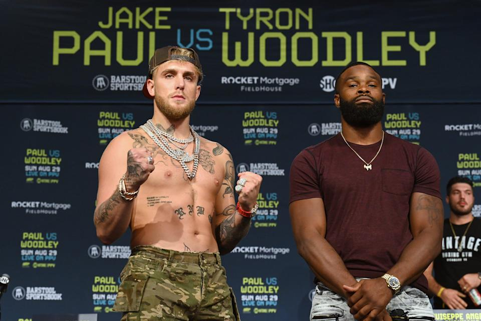 Jake Paul, left, and Tyron Woodley meeting in advance of Sunday's fight in Cleveland.