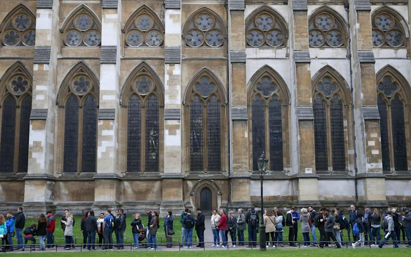 Westminster Abbey charges £20 for entry, while other cathedrals are free to visit - AFP