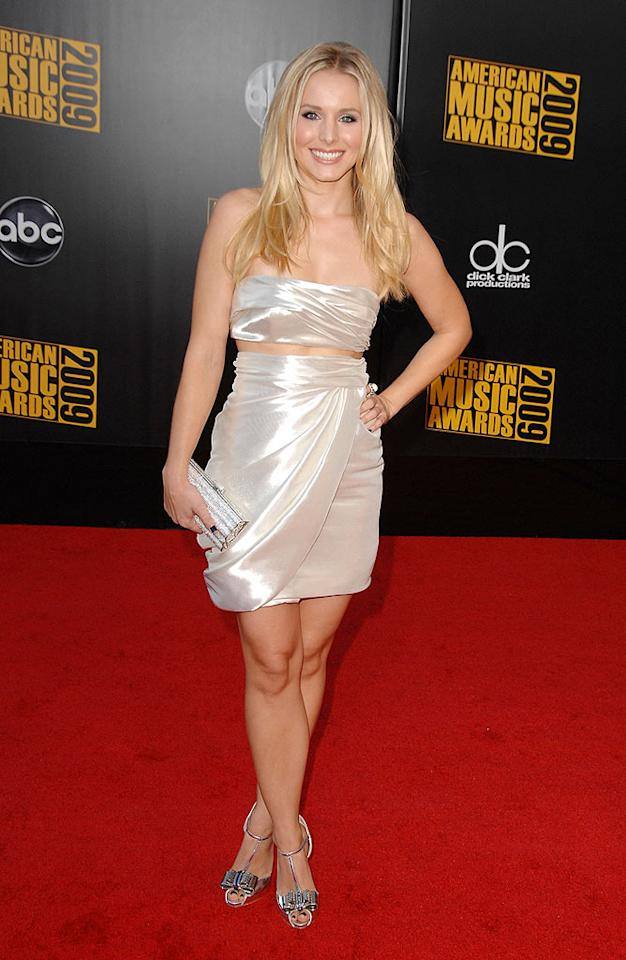 """Kristen Bell  Grade: A  The super cute movie star stole the spotlight in a shimmering two-piece showstopper and strappy sandals. Steve Granitz/<a href=""""http://www.wireimage.com"""" target=""""new"""">WireImage.com</a> - November 22, 2009"""